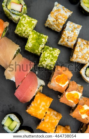 Sushi rolls on a black plate