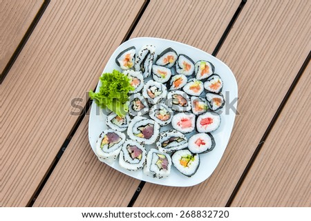 Sushi rolls on a plate from above - stock photo