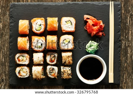 Sushi rolls on a slate plate - stock photo