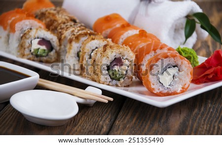 Sushi rolls,wasabi and ginger on a plate - stock photo