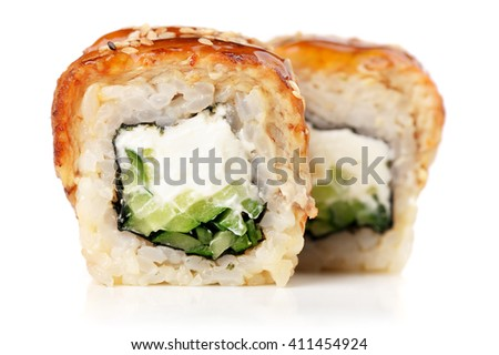 Sushi rolls with cream cheese, nori and cucumber covered with eel and caramel sauce - stock photo
