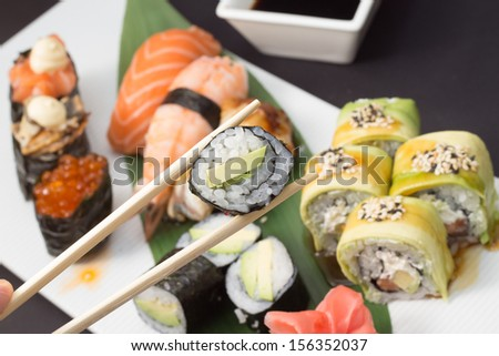 Sushi rolls with green dragon