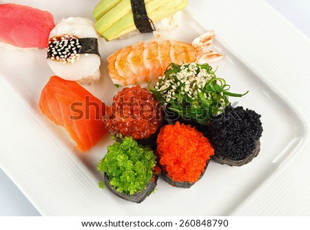Sushi rolls with red salmon,shrimp and  roe - stock photo