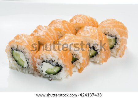 Sushi rolls with salmon and cucumbers