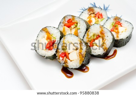 sushi rolls with salmon and vegetables on a square plate - stock photo