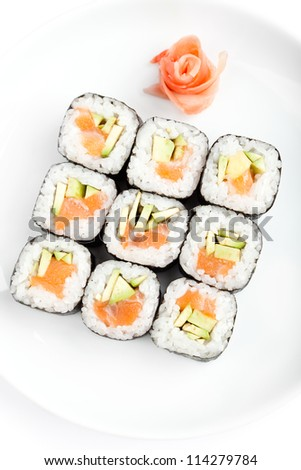 Sushi rolls with sashimi, isolated on white. Top view - stock photo
