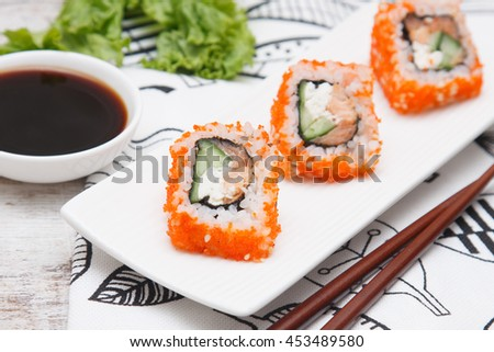 sushi rolls with vegetables, cream cheese, seafood