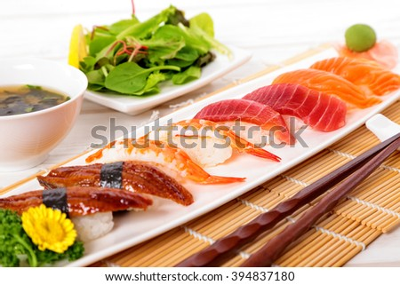 Sushi selection on plate with chopsticks - stock photo