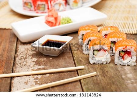 Sushi set and chopsticks next to it - stock photo