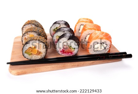sushi set in a kitchen board, isolated on white