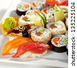 Sushi Set - Maki Sushi (alaskan roll, yin yang roll) and Nigiri Sushi (tuna, salmon, eel). - stock photo