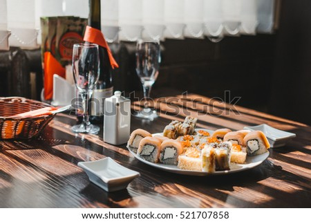 Sushi set on a table with champagne
