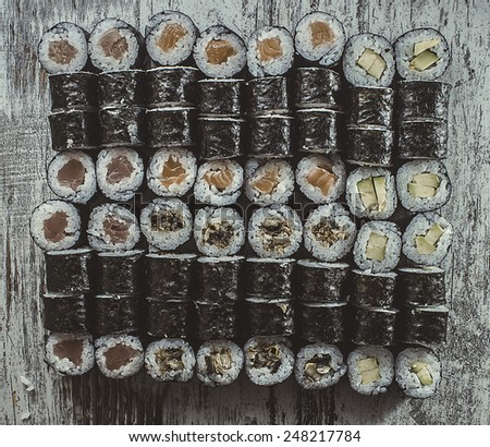 Sushi set on a wooden background