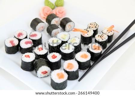 sushi set on white plate. Traditional japanese sushi rolls - stock photo