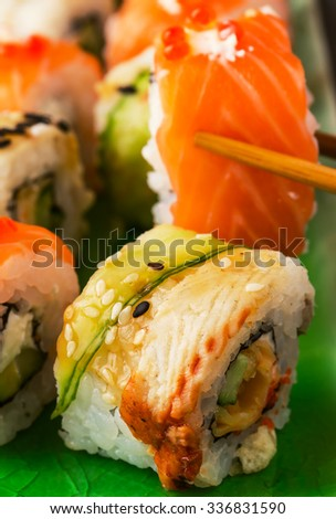 Sushi set: sushi roll with salmon and sushi roll with smoked eel, selective focus. - stock photo