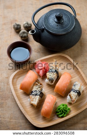 Sushi set with a soy sauce and tea, studio shot, selective focus - stock photo