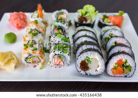 Sushi set with chopsticks on the plate - stock photo