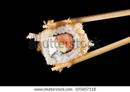 Sushi with chopsticks - stock photo