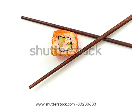 Sushi with chopsticks isolated over white background - stock photo