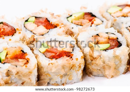 Sushi with fish and green caviar on white background