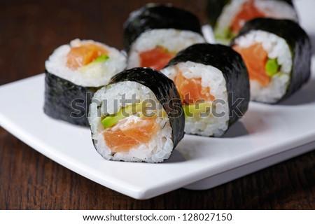 sushi with salmon and avocado - stock photo