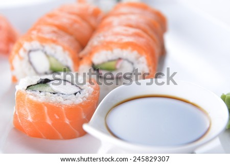 sushi with salmon and avocado on plate