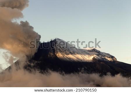 Susnet light over Tungurahua volcano erupting, view from Chimborazo county - stock photo