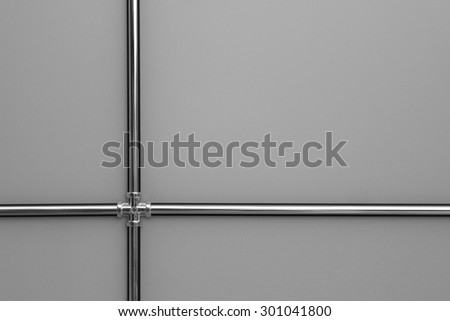 Suspended ceiling with metal channel trim / molding. Modern design solution for an office or residence. Design pattern for fragmentation of text over 4 frames. - stock photo