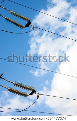 Suspended insulators of the high-voltage electric power transmission. - stock photo