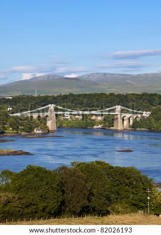 suspension bridge across the Menai Strait near Bangor built by Thomas Telford in 1826 - stock photo