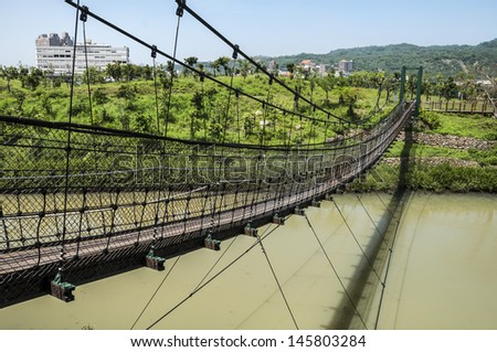 Suspension bridge at wetland park in Taiwan. - stock photo