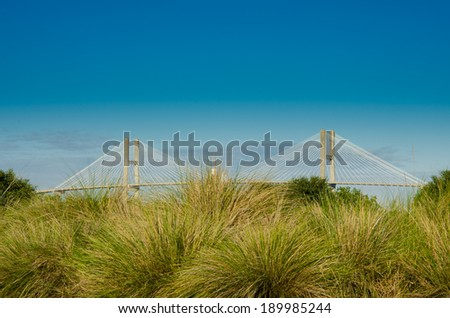 Suspension Bridge Connects Islets with Mainland - stock photo