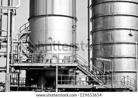 Suspension tanks in petrochemical plant - stock photo