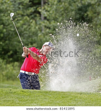 SUSSEX, CANADA - JULY 19: Blair Bursey of Gander, Newfoundland and Labrador, exits a sand trap at the CN Future Links Atlantic Championship on July 19, 2011 in Sussex, Canada.