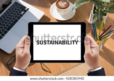 SUSTAINABILITY Businessman work  on tablet on screen - stock photo