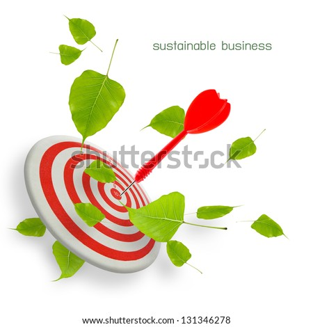 Sustainable business, dart hit the target with leaves isolated on white background - stock photo