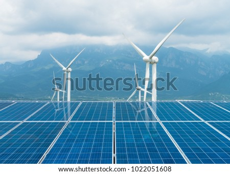 sustainable clean energy, solar panel and wind turbines closeup