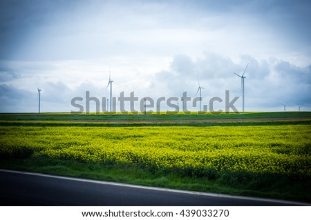 Sustainable Development.Symbol Sustainable Sevelopment.Renewable Energy.Wind Power Plant.Power Plant.Power Field.Rapeseed Field.Symbol Energy.Clean Energy.Wind Turbine. - stock photo