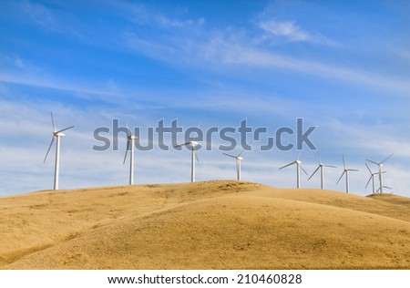 Sustainable electrical power generator powered by wind natural energy source, with copy space above and below the wind turbines