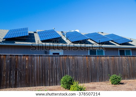 Sustainable energy from the sun goes into these solar panels on top of a house in Oregon. - stock photo