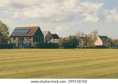 Sustainable English housing development near a park in Cambridge, England - stock photo