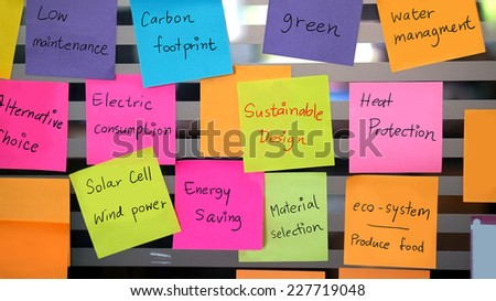 sustainable, green design concept on colourful post it - stock photo