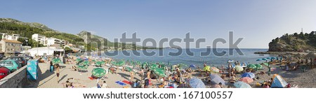 SUTOMORE, MONTENRGRO � JUNE 26: Tourists are relaxing on the beach on June 26, 2013 in Sutomore, Montenegro.
