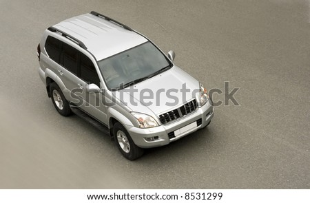"""suv car isolated drives on road at speed from my """"luxury cars"""" series - stock photo"""