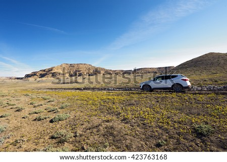SUV in blooming desert, Cottonwood Canyon Road, Utah - stock photo