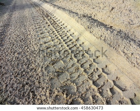 SUV wheel trace on the desert road after the rain in the Western Kazakhstan