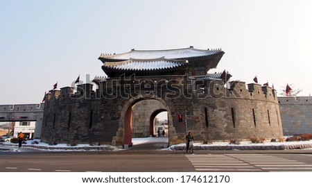 SUWON, SOUTH KOREA - DEC 21: Hwaseong Fortress in Suwon, South Korea on December 21, 2013. Hwaseong Fortress is the wall surrounding the center of Suwon, the provincial capital of Gyeonggi-do. - stock photo