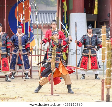 SUWON, SOUTH KOREA - October 30, 2014 : Korean soldier with traditional Joseon dynasty during show martail arts at Hwaseong haenggung square. Photo taken on October 30, 2014 in Suwon, South Korea