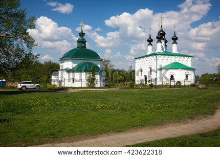 Suzdal, Russia, Circa May 2016. Entry into Jerusalem Church and the Church of St. Paraskeva in Suzdal, Vladimir region, Golden Ring of Russia - stock photo