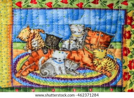 SUZDAL, RUSSIA - JULY 16, 2016: Feast of cucumber in Suzdal, handmade quilt depicting cats